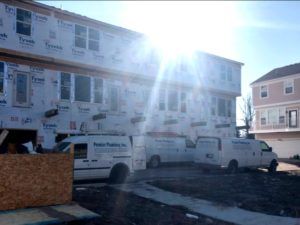 premier plumbing inc. arrives at new construction site
