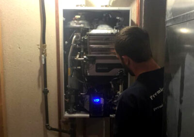 plumber servicing tankless water heater