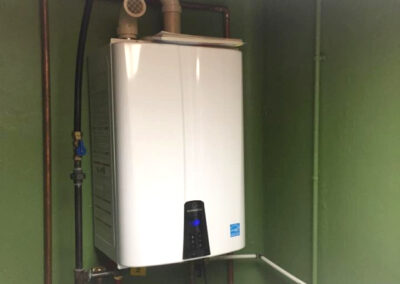 new tankless water heater installed in laundry room